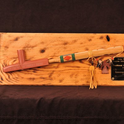 Peace pipe mounted on plaque
